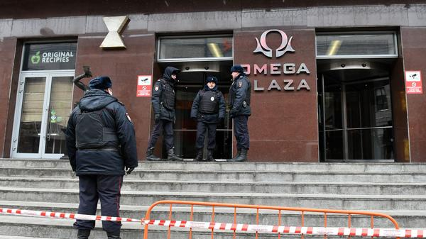 Russian police officers gather Jan. 28 at the entrance to the business center that houses the office of opposition leader Alexei Navalny's Anti-Corruption Foundation in Moscow. Police broke into the headquarters using a saw, and detained several members of Navalny's team.