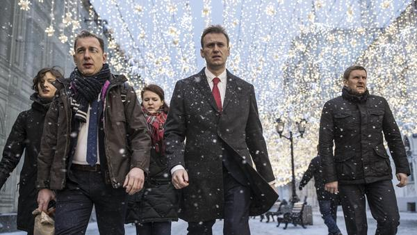Russian opposition leader Alexei Navalny, center, heads to a meeting of the Russia's Central Election commission in December. Officials formally barred him Alexei Navalny from running for president in the March 18 election, which he says is a predetermined sham.