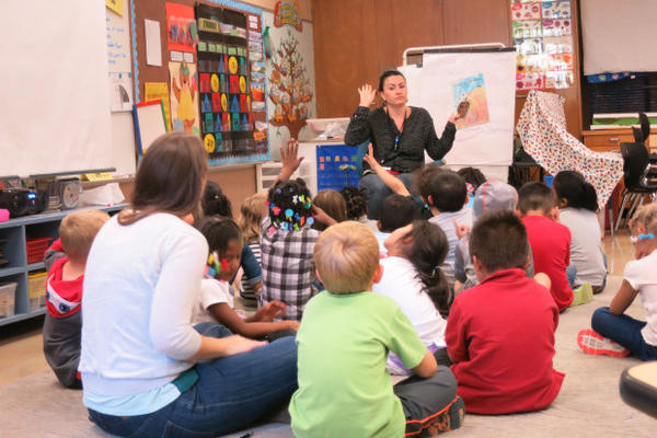 """<p>Alder Elementary School teacher Katie Metko follows up a game of """"Simon Says"""" by reading a fable to her kindergarten class.</p>"""