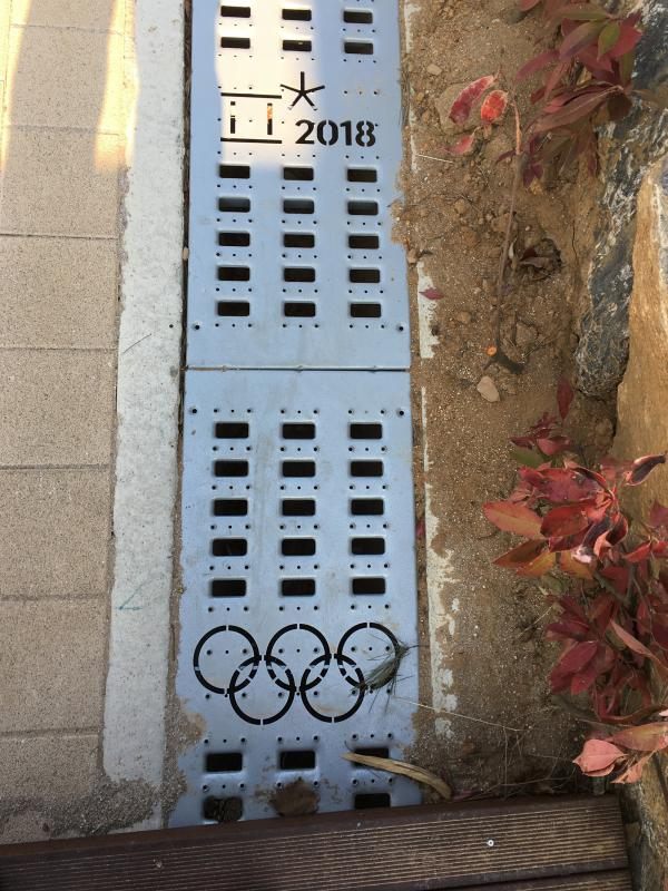 The work to build facilities and boost infrastructure in Pyeongchang and Gangneung included placing customized drain grates along walkways.