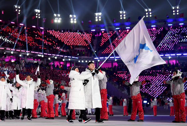 North and South Korean athletes enter together under the Korean unification flag during the parade of athletes.