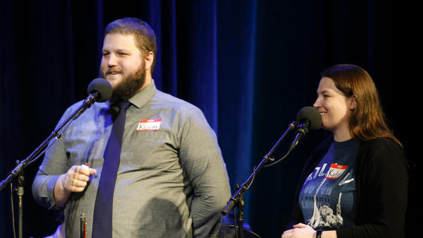 Contestants Kevin Combes and Katie Fox play a game about real and fictional podcasts on NPR's Ask Me Another at The Warner Theatre in Washington, D.C.