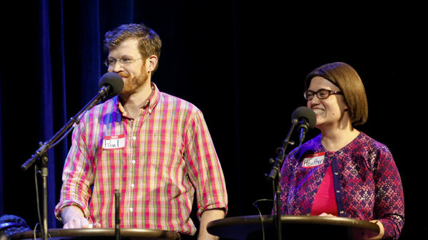 Contestants Paul Nicholsen and Heather Hurley prepare for their first game on NPR's Ask Me Another at The Warner Theatre in Washington, D.C.