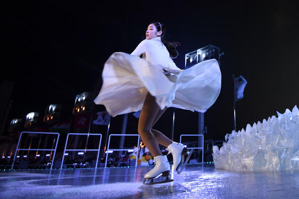 South Korean figure skater Yuna Kim performs before lighting the Olympic cauldron.