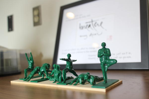 Artwork in the office of Dr. Greg Serpa at the West Los Angeles VA includes toy army men in yoga poses.
