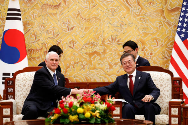 South Korean President Moon Jae-in shakes hands with U.S. Vice President Mike Pence during their meeting at the presidential office in Seoul, South Korea. Vice President Pence is visiting South Korea and will lead the U.S. delegation in the opening ceremony of the Winter Olympics.