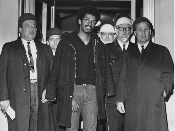 Cleveland Sellers, center, stands with officers after his arrest in Orangeburg, S.C., where three were killed and others wounded during a demonstration on Feb. 9, 1968.