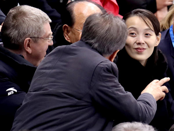 Kim Yo Jong has captured attention during her visit to the Pyeongchang Winter Olympics. Here, South Korea's President Moon Jae-in speaks to Kim as International Olympic Committee President Thomas Bach looks on, at the first game of the unified Korean women's hockey team Saturday.