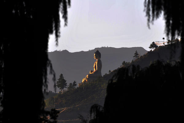 A towering statue of Buddha overlooks Thimphu Valley. At 170 feet high, it is one of the largest figures of Buddha in the world.