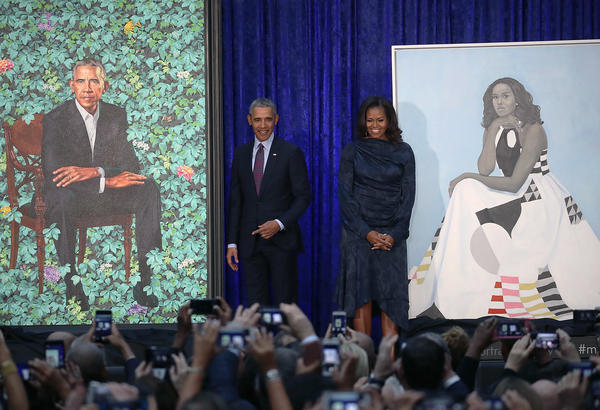 Former President Barack Obama and former first lady Michelle Obama stand next to their newly unveiled portraits during a ceremony Monday at the Smithsonian's National Portrait Gallery in Washington, D.C.