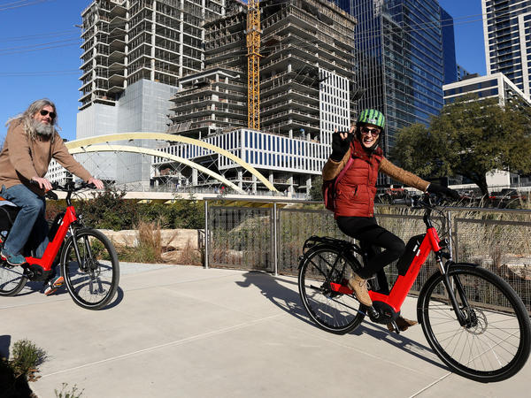 Joel Parker (left) and Leigh Salinas (right), participants in the Center for Austin's Future ATXelerator program, take a bike tour through the city on Jan. 13, 2018.