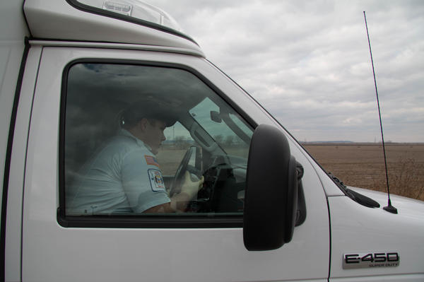 Atchison-Holt EMT Keaton Shaw radios to dispatch that his ambulance is on the scene.