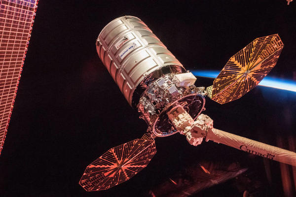 ATK's Cygnus cargo spacecraft is seen at sunrise, prior to its departure from the International Space Station.