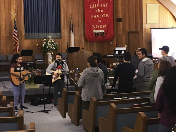 Young worshippers at Erez Baptist Church in Duncanville, Texas, gather for a midweek music service. The congregation, less than a year old, consists almost entirely of Hispanic immigrants and their children.