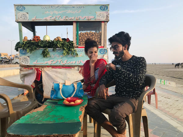 On Karachi beach where residents splash in the Arabian Sea, Arioch William, 18, and his girlfriend Sheza, 17, celebrated Valentine's Day a few days early.