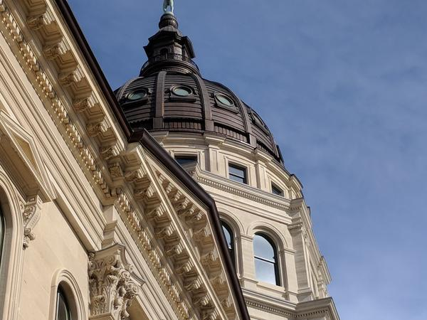 A bill under consideration in the Kansas Statehouse would set a standard of equally shared child custody in disputed divorces