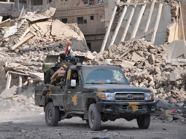 Syrian pro-government forces patrol in the eastern city of Deir el-Zour in November.