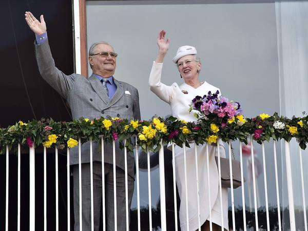 Danish Queen Margrethe and Prince Consort Henrik wave from the balcony at Aarhus City Hall in 2015 before a celebration of Queen Margrethe's 75th birthday.