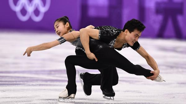 North Korea's Ryom Tae Ok (left) and Kim Ju Sik compete in the pair skating short program of the figure skating event during the Pyeongchang 2018 Winter Olympic Games at the Gangneung Ice Arena on Wednesday.