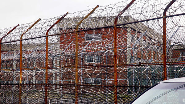 A security fence surrounds the inmate housing on New York's Rikers Island correctional facility in New York.