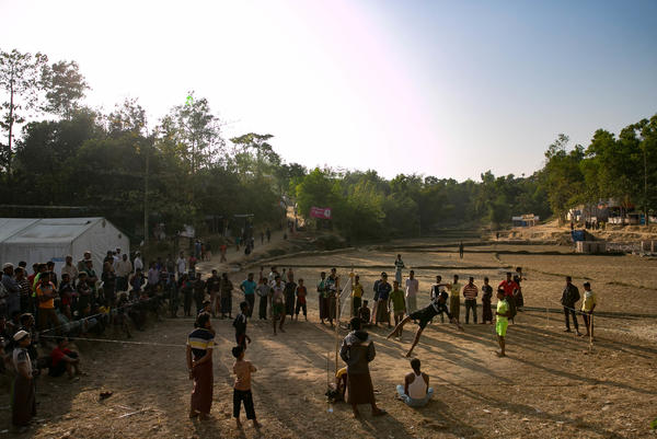 Refugees play a game that's a cross between volleyball and soccer in the Hakimpara camp.