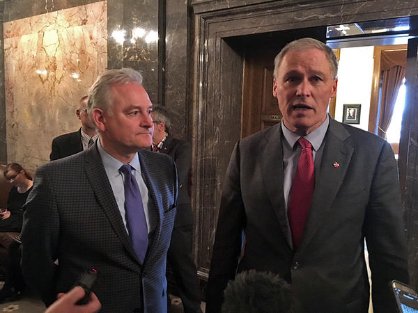 Washington Gov. Inslee speaks with reporters alongside Democratic state Sen. Reuven Carlyle after the Senate voted to abolish the death penalty.