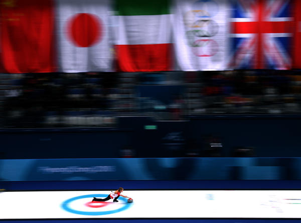 Kaitlyn Lawes of Canada throws her rock on the way to a win against Norway in the curling mixed doubles semifinals.