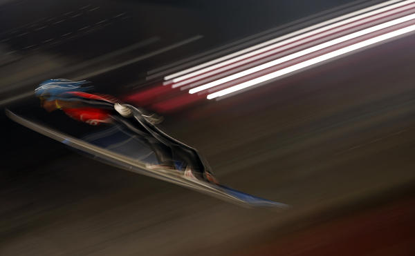Russian Denis Kornilov trains Thursday for the men's large hill individual ski jumping.