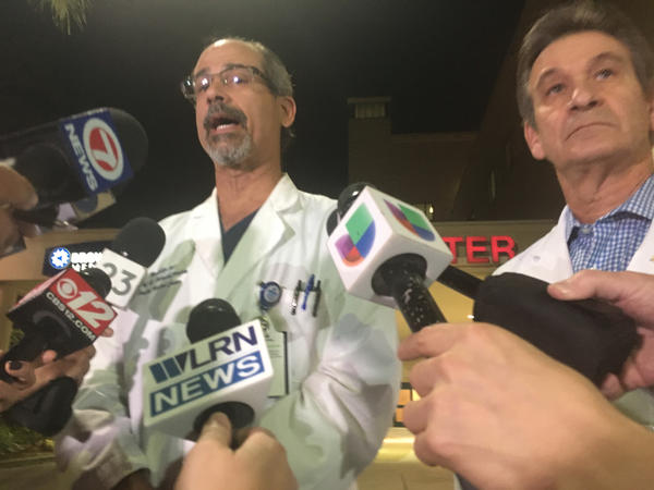 Dr. Benny Menendez, medical director for Broward Health's emergency department, briefs reporters Wednesday evening on the condition of patients from the shooting at Marjory Stoneman Douglas High School.