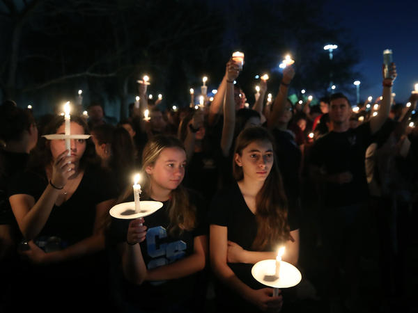Students and family members at the vigil at Pine Trails Park, a day after the shooting rampage that killed 17 people.
