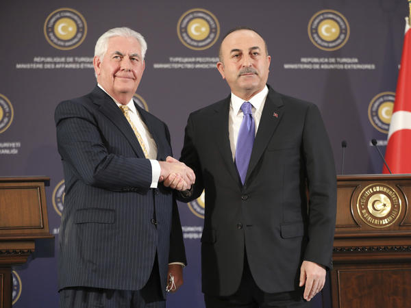 Turkey's Foreign Minister Mevlut Cavusoglu, right, shakes hands with U.S. Secretary of State Rex Tillerson, left, after a joint news conference following their meeting Friday in Ankara, Turkey.