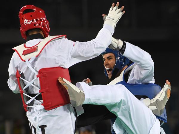 Taufatofua (right) competes against Iran's Sajjad Mardani in the men's taekwondo qualifying bout at the 2016 Rio Olympics.