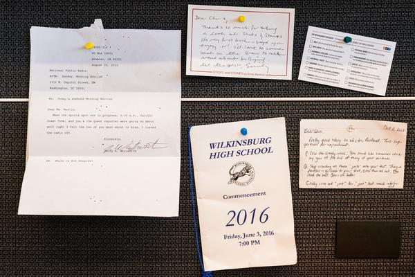 On Chris' wall, a Wilkinsburg High School commencement program book and fan mail.