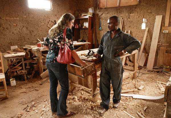 Marion Grace Woolley (left) had a crazy idea. Could carpenter Désiré Mulumeoderwa build a piano? He thinks he can.