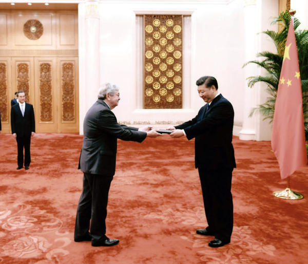 U.S. Ambassador Terry Branstad presents his credentials to China's President Xi Jinping, July 12, at the Great Hall of the People in Beijing.