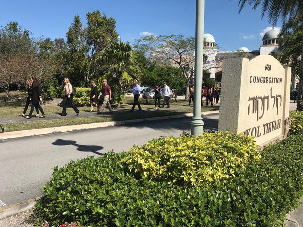 Mourners leave Congregation Kol Tikvah in Parkland after services for Meadow Pollack, who was killed Wednesday at Marjory Stoneman Douglas High School.