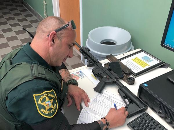 Ben Dickmann surrendered his AR-57 and two 50-round magazines to the Broward County Sheriff's Office Friday. His decision comes after a shooting at a high school in nearby Parkland, Fla. left 17 dead and others injured.