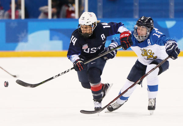 Brianna Decker (left) of the United States and Riikka Valila of Finland battle for the puck during an Olympics semifinal matchup on Feb. 19, 2018 in Pyeongchang-gun, South Korea. (Jamie Squire/Getty Images)