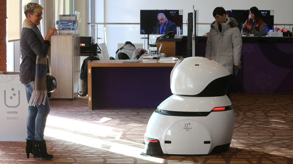 A robot sweeps the floor at the main press center at the Pyeongchang Winter Olympics.