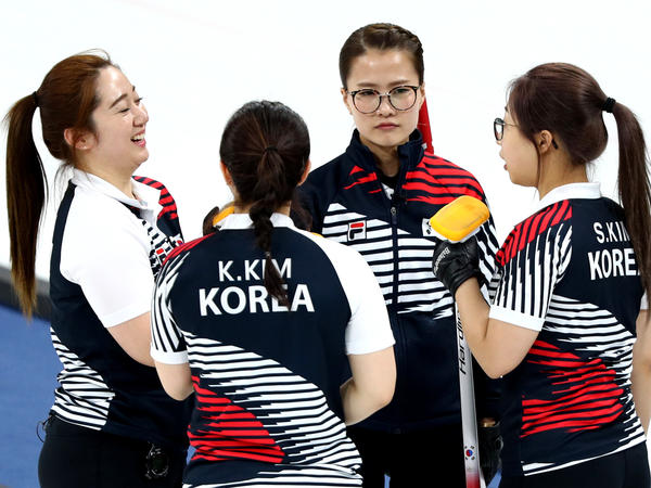 (From left) Teammates Yeong Mi Kim, Kyeong Ae Kim, Eun Jung Kim and Seon Yeong Kim talk together during a women's curling round robin at the Winter Olympics on Friday.