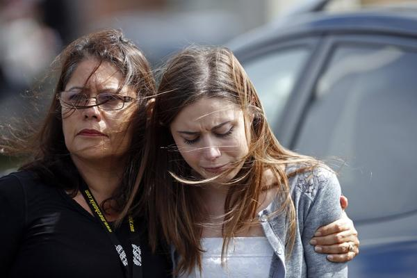 Mourners hug as they leave the funeral of Alaina Petty, in Coral Springs, Fla. Monday.