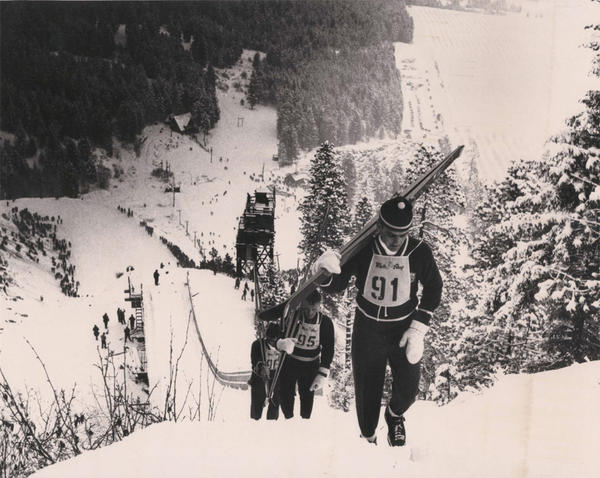 In the heyday of ski jumping at the Leavenworth Ski Hill, competitors climbed a walkway to the top of the large ski jump.