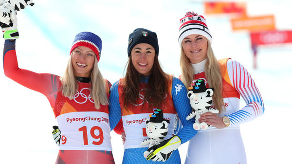Bronze medalist Lindsey Vonn, right, celebrates on the podium with gold medalist Sofia Goggia of Italy, center, and silver medalist Ragnhild Mowinckel of Norway, after the women's downhill in the Pyeongchang Winter Olympics.