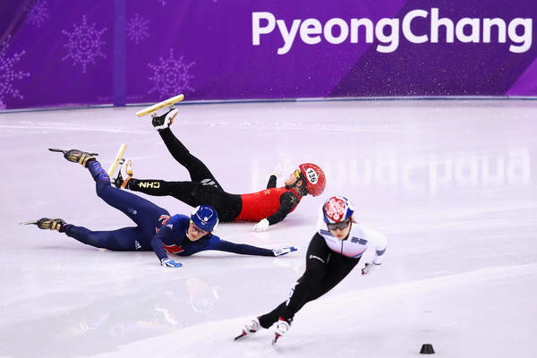 Speedskaters Li Jinyu of China and Elise Christie of Great Britain fall as Choi Min-jeong of South Korea skates past during the short track 1,500-meter semifinals on Feb. 17.
