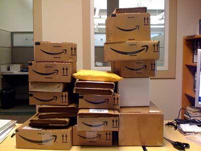 Boxes from Amazon.com. An Illinois retailer that might sell products through online retailers, such as Amazon.com, now must charge sales tax for their online sales, according to a new law.