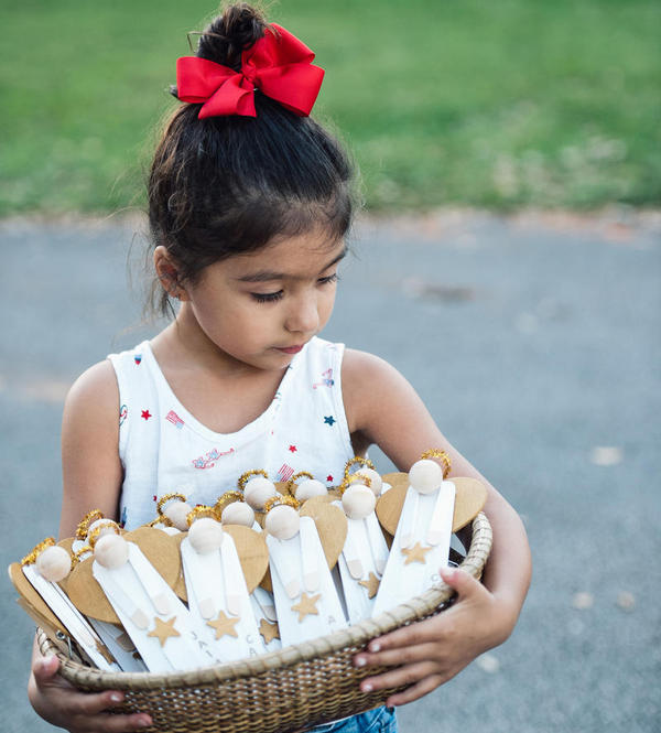 Leah Ortega cradles the 17 angels she helped make to honor the 17 Parkland mass shooting victims.
