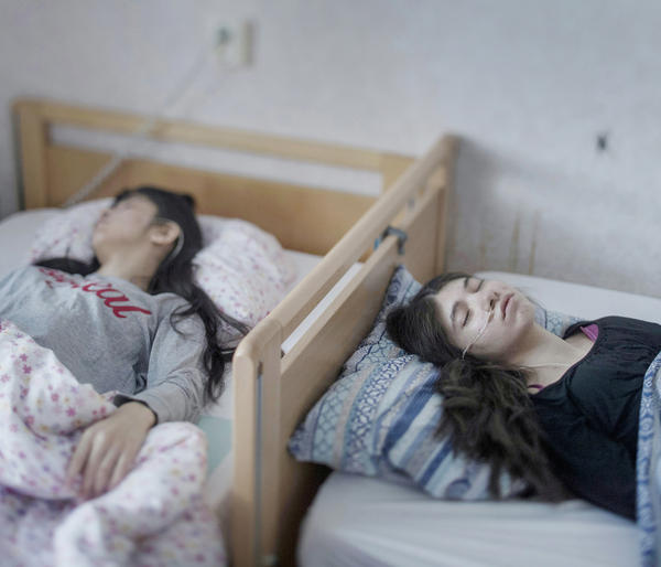 Djeneta (right) has been bedridden and unresponsive for two and a half years, and her sister Ibadeta for more than six months. The girls, who live in Horndal, Sweden, have been diagnosed with <em>uppgivenhetssyndrom</em>, or resignation syndrome. It is a condition believed to exist only amongst refugees in Sweden.