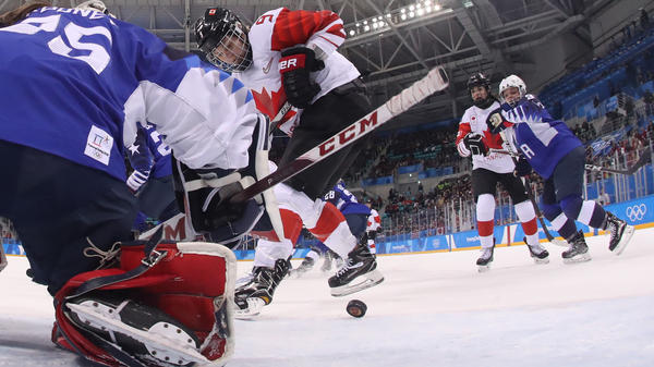 Canada's Jennifer Wakefield tries to get the puck past USA's goalie Maddie Rooney in the women's gold medal ice hockey match between Canada and the U.S. at the Pyeongchang 2018 Winter Olympic Games.