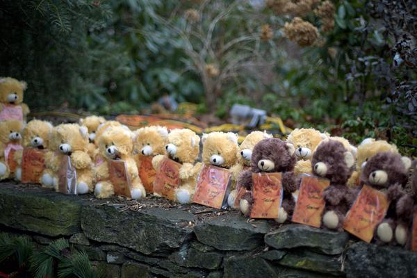 Teddy bears, each representing a victim of the Sandy Hook Elementary School shooting, sit on a wall at a sidewalk memorial in Newtown, Conn. A gunman walked into Sandy Hook Elementary School in Newtown Friday and opened fire, killing 26 people, including 20 children in 2012.