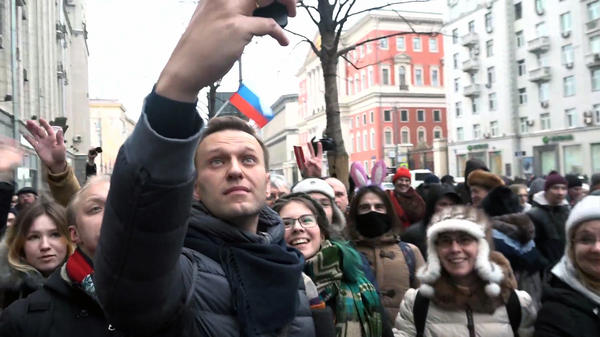 Alexei Navalny takes a selfie with his supporters during a rally last month calling for a boycott of the presidential election in March, which he has been banned from running in.